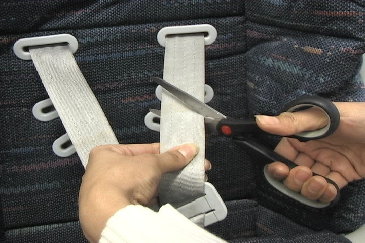 Cutting off harness straps of car seat