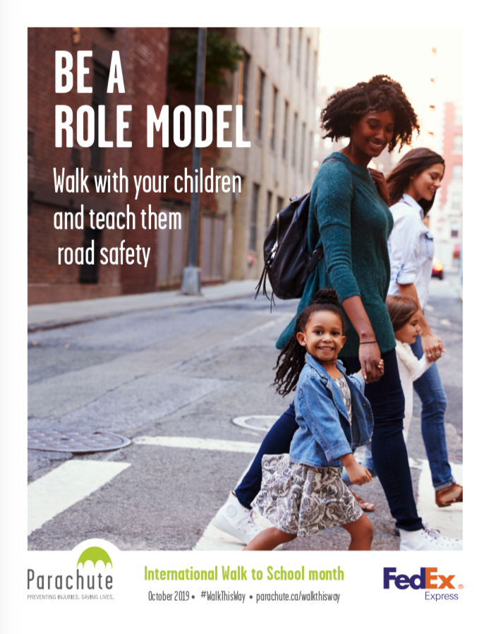 Woman walking with three children at a crosswalk: poster for International Walk to School month